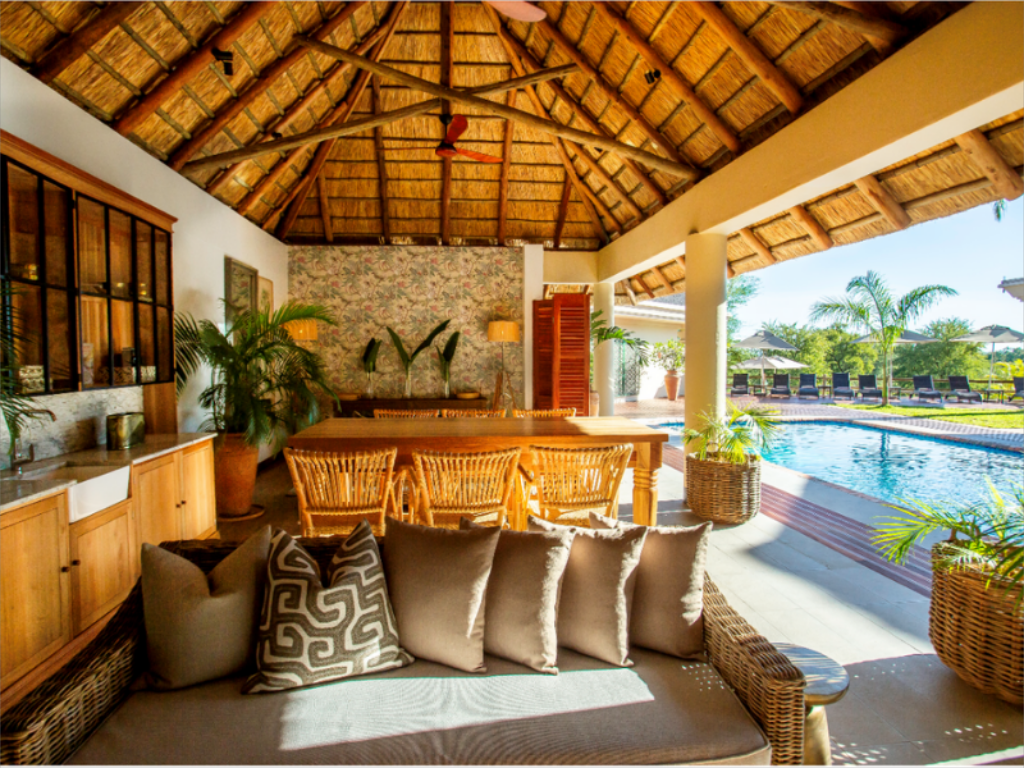 Lounge and dining area by the pool